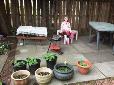 Freya Modelling the Potato Patch (Behind Her) and the Pots